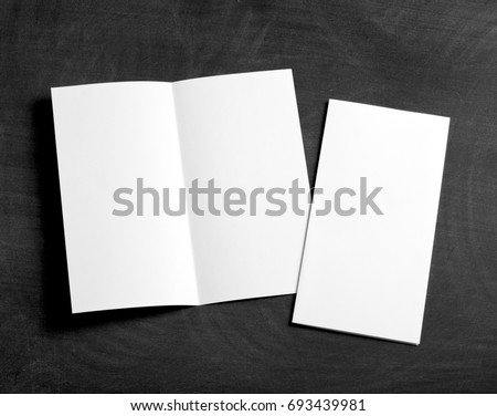Identity design, corporate templates, company style, set of booklets, blank white folding paper flyer on a black chalkboard #693439981