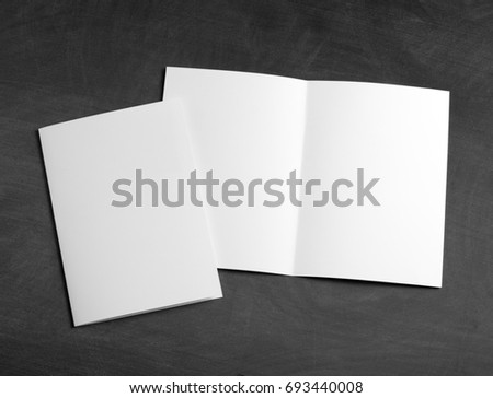Identity design, corporate templates, company style, set of booklets, blank white folding paper flyer on a black chalkboard #693440008
