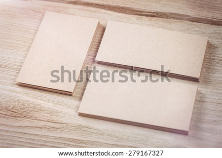 Identity Design, Kraft Paper Corporate Business Card on aged wooden background