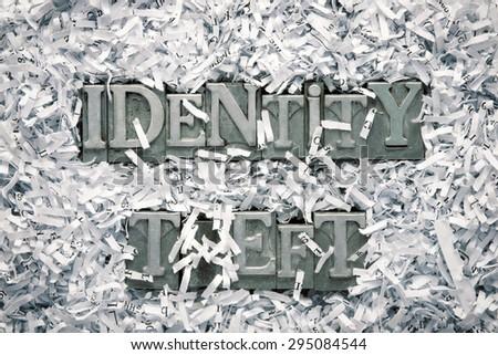 identity theft phrase made from metallic letterpress type inside of shredded paper heap