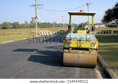 Idle road work machines in Australia. Road building machinery Tandem smooth drum roller at construction site.
