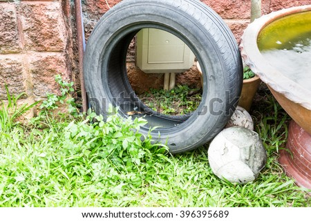 Idle used tire at open area potentially store stagnant rain water and become mosquitoes breeding ground