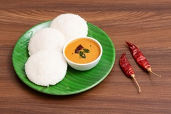 Idli Sambhar or Idly with red chutney is a popular south Indian food, served with coconut chutney. steam made healthy breakfast dish of Kerala, Tamil Nadu India. Indian food
