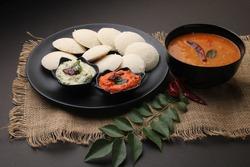 Idly sambar or Idli with Sambhar and green, red chutney. Popular South indian breakfast