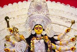 Idol of Goddess Durga during Durga puja at Kolkata . Durga Puja also called Durgotsava is an annual Hindu festival celebrated Kolkata and various parts of India .