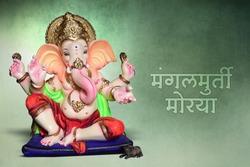 "Idol of lord Ganesha, Ganpati festival, Marathi calligraphy ""Mangal Murti Morya""."