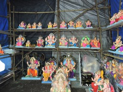 idols of shree ganesha made by clay and coloured  verity of idols kept for the sell in mumbai made for the occasion of ganesh chaturthi festival india