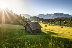 Idyllic alpine hut at sunrise in Bavaria, Allgäu, Germany