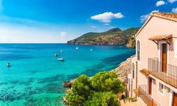 Idyllic bay with boats at the coast of Camp de Mar, Majorca island, Spain Mediterranean Sea, Balearic Islands.