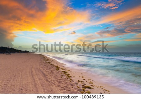 Idyllic beach of Caribbean Sea at sunrise