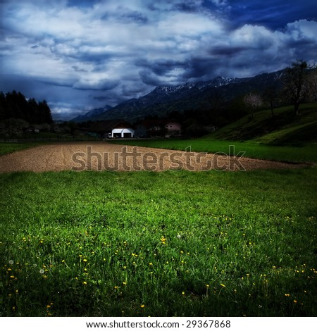 Idyllic country landscape and dramatic blue sky