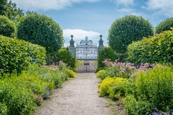 Idyllic garden in Dunrobin Castle in a sunny day, Sutherland county, Scotland.