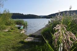 Idyllic lakeside landscape, Boat, footbridge and island on Ratscher Lake, Talsperre Ratscher, Heckengereuth, Thuringia, Germany