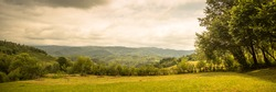 Idyllic landscape in mountains. Rural scene. Long format.