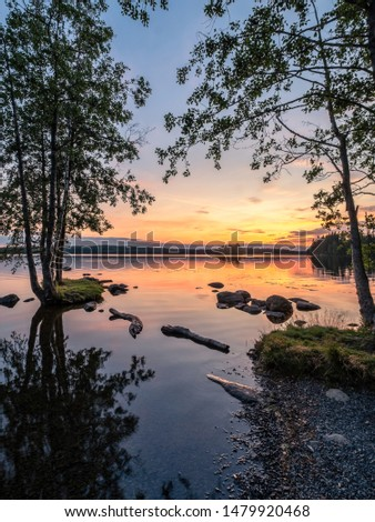 Idyllic landscape with beautiful sunset and tranquil mood at summer evening in Loppi, Finland