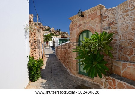 Idyllic narrow street in greek town of Lindos, Rhodes