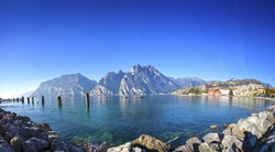 Idyllic panorama of Lake Garda and the town of Torbole in winter