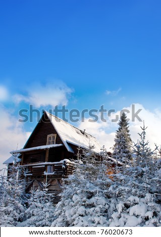 Idyllic photo of a mountain house during the winter.
