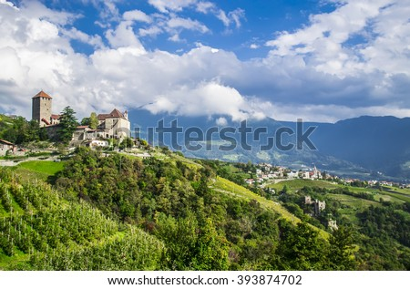 Idyllic rural landscape with a castle and vineyards. Merano, South Tyrol, Italy