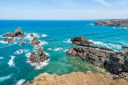 Idyllic seascape with extraordinary rock formations in the Atlantic Ocean at Alteirinhos beach in Zambujeira do Mar, Vicentine Coast Natural Park PORTUGAL