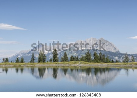 idyllic small mountain lake Schlosser  before the summit of the Wilder Kaiser