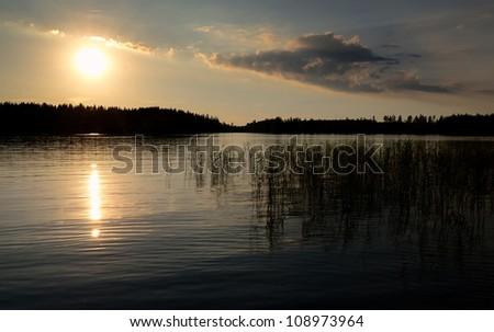 Idyllic summer lake sunset