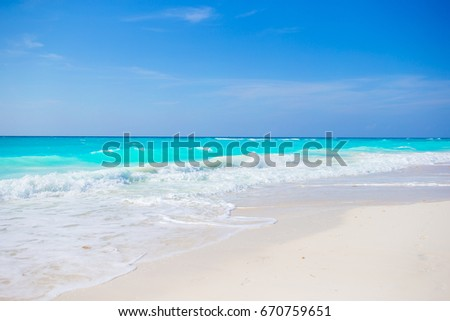 Shutterstock Idyllic tropical beach on Cuba in Caribs with white sand, turquoise ocean water and blue sky