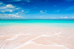 Idyllic tropical beach with white sand, turquoise ocean water and blue sky