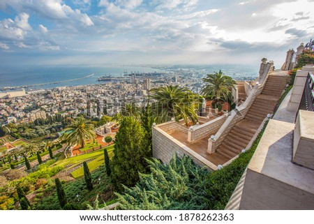 Idyllic  view of Haifa including part of the Bahai Gardens and the town's seaport. Sunny morning and awe skyscape and Mediterranean Sea