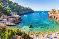 Idyllic view of the beautiful beach of Cala Deia, Majorca island, Mediterranean Sea.