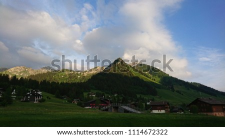 Idyllic view on Pic Chaussy from Col des Mosses on a pleasant Spring evening - Switzerland - chalet landscape underneath and focused light