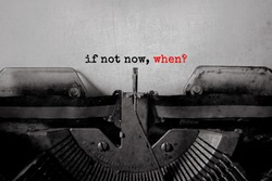 if not now, when? typed words on a Vintage Typewriter.
