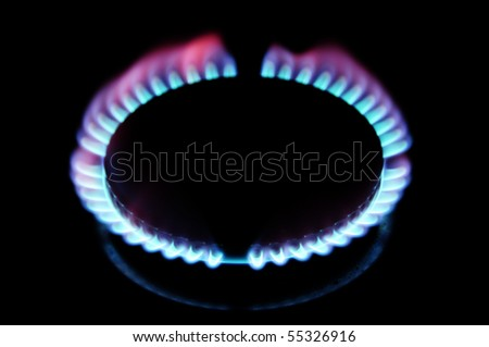 igniting a gas stove on a black background