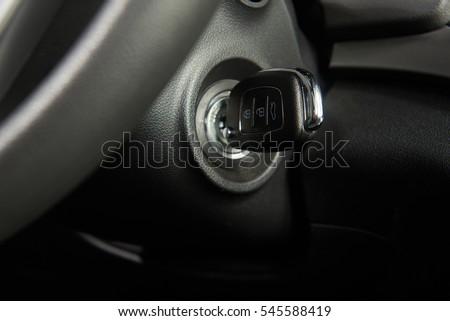 Ignition key of modern car close up. Car key in keyhole