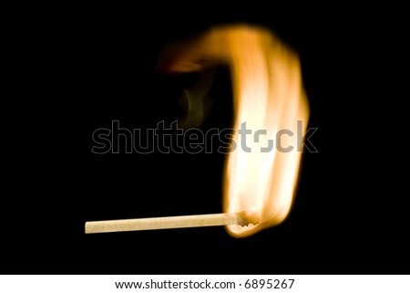 Ignition of a matchstick on black slow shutter