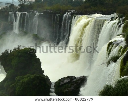 Iguazu Falls - waterfalls on the Iguazu River on the border of Brazil and Argentina,  width of 2.7 km and includes approximately 270 separate waterfalls. Height of drop of water reaches 82 meters.