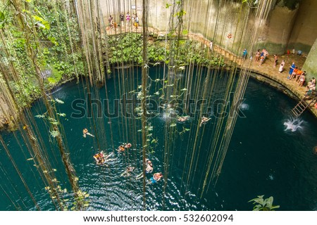 Shutterstock Ik-Kil Cenote near Chichen Itza, Mexico. Lovely cenote with transparent waters and hanging roots
