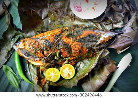 Ikan Bakar - Malaysian famous street food. Grill fish wrapped in banana leaf with a lots of spices.