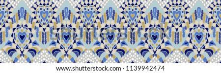 Ikat geometric folklore ornament. Tribal ethnic vector texture. Seamless striped pattern in Aztec style. Figure tribal embroidery. Indian, Scandinavian, Gypsy, Mexican, folk pattern.  - Shutterstock ID 1139942474