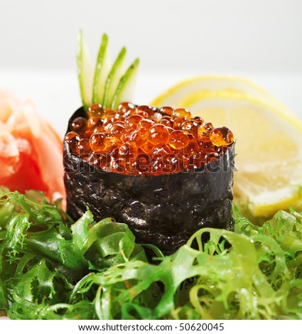 Ikura (Salmon Roe) Gunkan Maki Sushi with Cucumber - stock photo