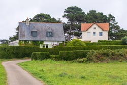Ile de Brehat, France - August 27, 2019: Country House with Flower Garden at picturesque Ile de Brehat island in Cotes-d'Armor department of Brittany