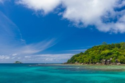 Ile Moyenne island and a small Ile Seche islet on the background in the Saint-Anne Marine National Park in Seychelles on a sunny day