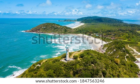 Ilha do Mel - Paraná. Aerial view of the Conchas lighthouse and beaches of Ilha do Mel Foto stock ©