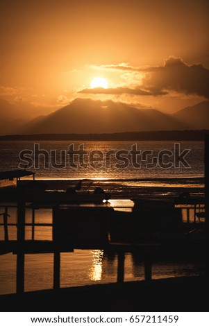 Ilha Do Mel, Parana, Brazil - June 3, 2017: Sunset behind the mountain in the Honey Island.