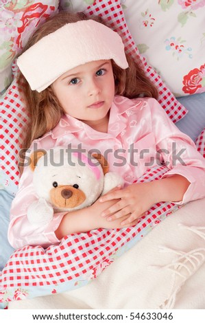 Ill girl with teddy bear in the bed  ( No-name teddy bear )