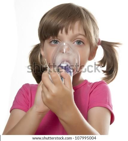 ill little girl using inhaler - respiratory problems white background