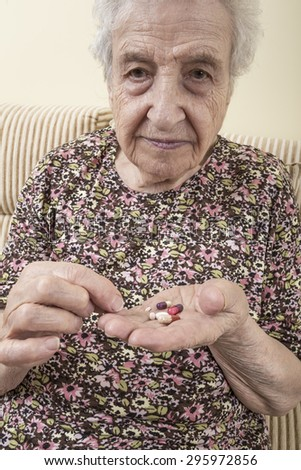 ill senior woman taking pill