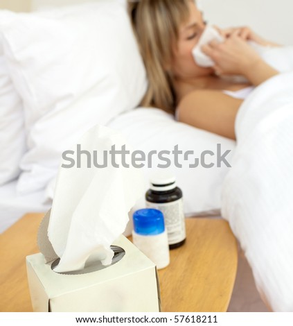 Ill woman lying in bed at home