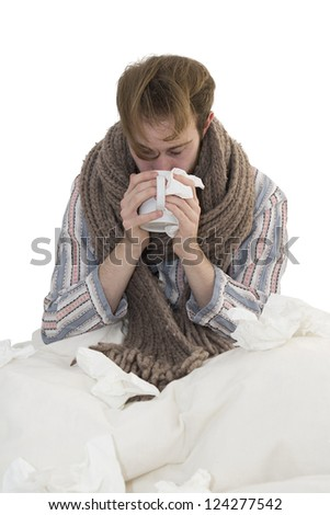 Ill Young Man In Bed Drinks a Cup Of Tea