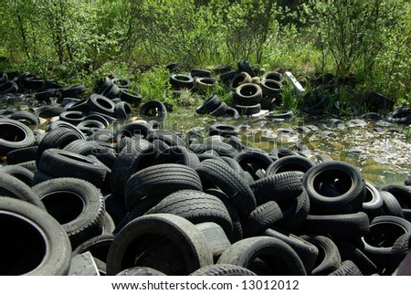 Illegal tire dump - stock photo